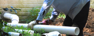 cutting a pvc sewer pipe