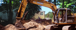 septic crew using a backhoe